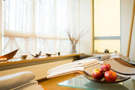 wellness center: Apple on a plate in luxury spa room