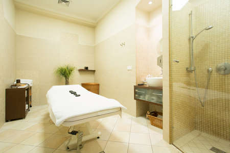 Interior of massage room in wellness center Stock Photo - 34249730