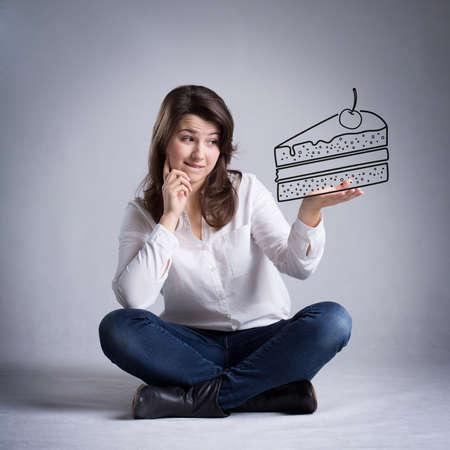 decission: Ragazza che sogna di mangiare un pezzo di torta
