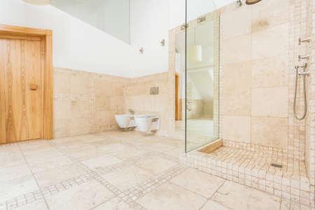 Stylish space bathroom with rock floor photo