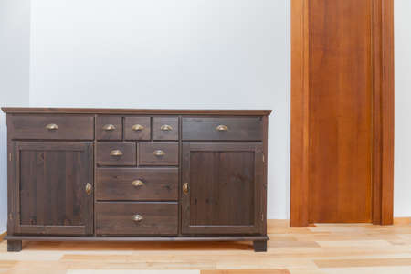 commode: Antique wooden commode in bright bedroom