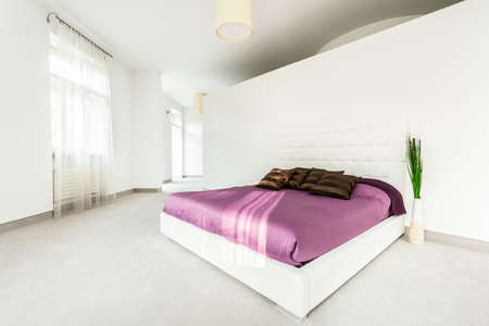 View of spacious bed in bright bedroom photo