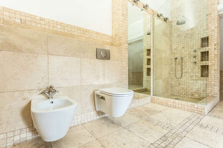 Horizontal view of interior of beige bathroom photo