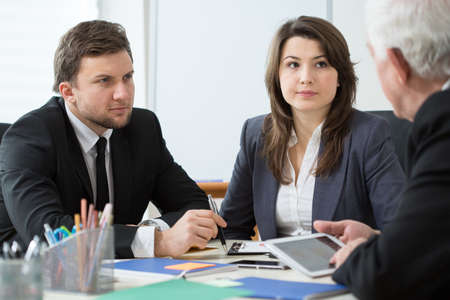 experienced: Young employees talking with boss during business appointment