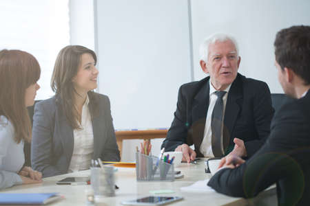 Group of businesspeople establishing business strategy of firm photo