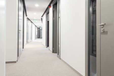 Long corridor with a lot of doors Stockfoto