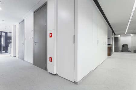 room door: Corridor of business office with grey doors