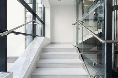 stairs interior: Horizontal view of white stairs in business building