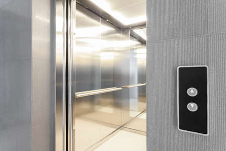 adapted: Close-up of entry to elevator in modern building Stock Photo