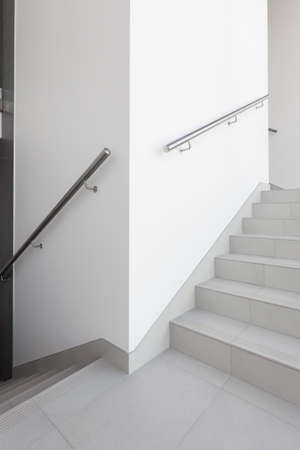 Vertical view of stairs with steel railing