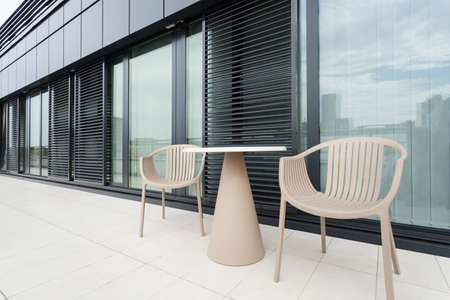 Table and chairs in front of office building