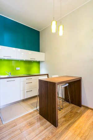 compact: Small dining space in modern, green kitchen