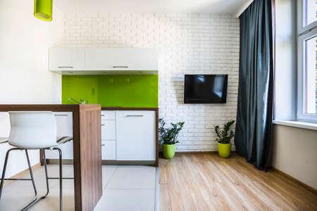 Modern studio flat interior with white bricks Stock Photo