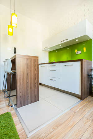 kitchenette: Green dining space in modern hotel apartment Stock Photo