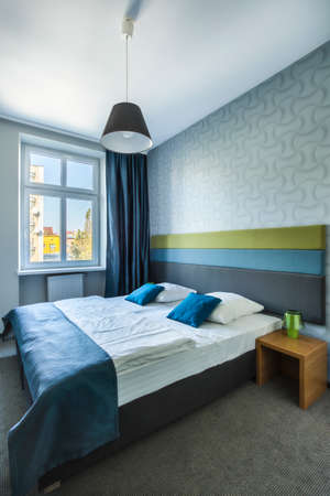 double beds: Spacious bedroom with twin bed in hotel room