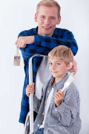 priming paint: Image of dad and son renovating house
