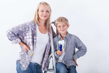 priming paint: Mum and son going to renovate their house Stock Photo