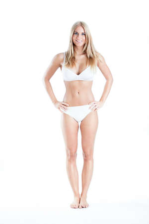 Slender woman in white underwear on white background Stock Photo