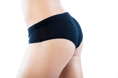 Close-up of young slim woman perfect buttock in black pants