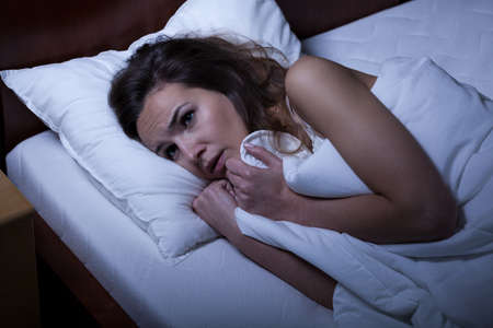 trying on: Image of scared woman trying to sleep Stock Photo