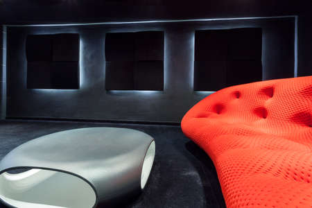 home cinema: Modern sofa and table in a dark interior Stock Photo
