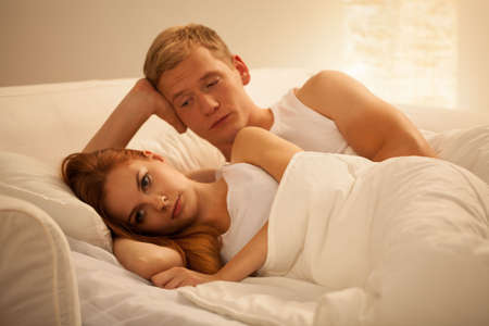 sex on bed: Young attractive couple having problem in bed
