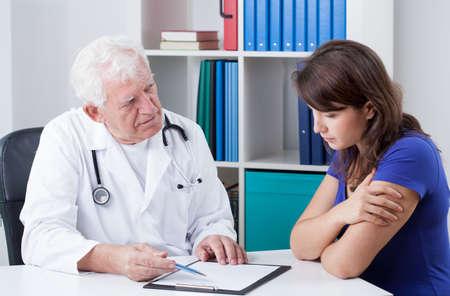 Senior family docotr and his patients bad diagnosis photo