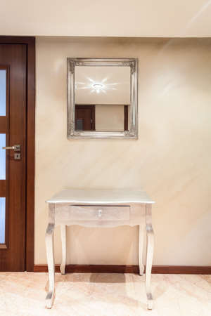 anteroom: Table with drawer in modern apartment, vertical