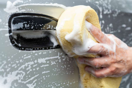 muck: Manual car wash by young man