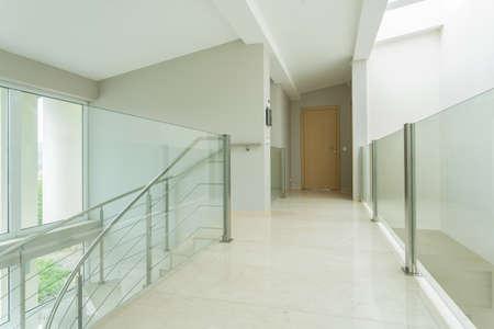 Horizontal view of spacious hall in luxury apartment photo
