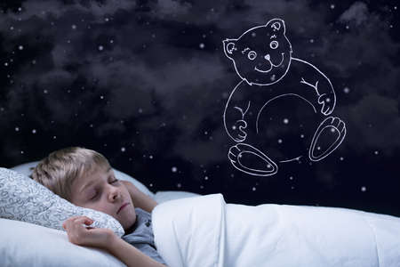 sleep baby: Image of little cute boy dreaming about his teddy bear