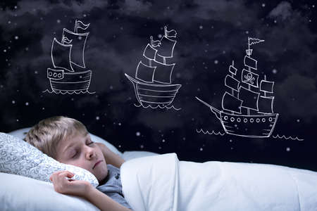 infant school: Sleeping little boy having a dream about big adventure Stock Photo