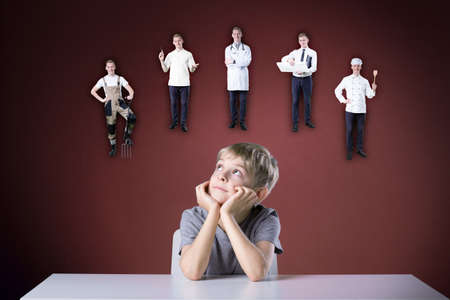education choice: Little boy thinking about his future Stock Photo