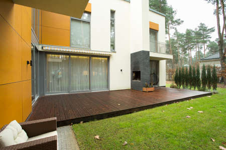 front entry: View of patio and garden during autumn time