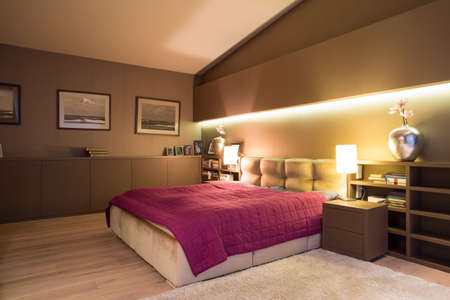 warm color: Spacious cozy bedroom with comfortable double bed