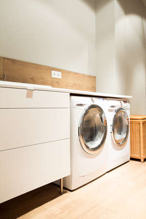 laundry room: Picture of home laundry with two washing machines