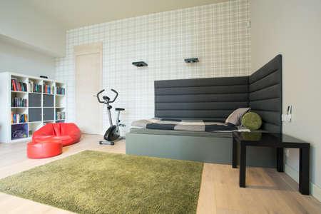 teen bedroom: Stationary bicycle in room of teenage boy Stock Photo