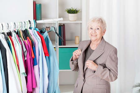 Older elegant lady in brown jacket