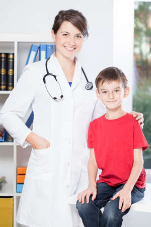 Little happy boy and his young pretty pediatrician Stock Photo