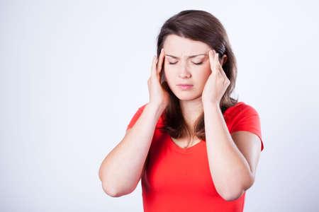 cephalgia: Portrait of woman having pain in temples Stock Photo