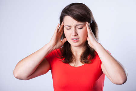 cephalgia: Portrait of woman suffering from terrible headache Stock Photo