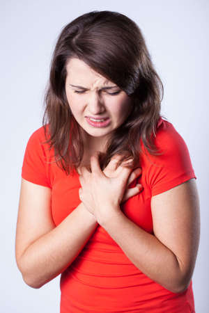 woman chest: Suffering young woman having pain in chest