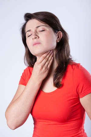 Brunette girl having flu and sore throat Stock Photo