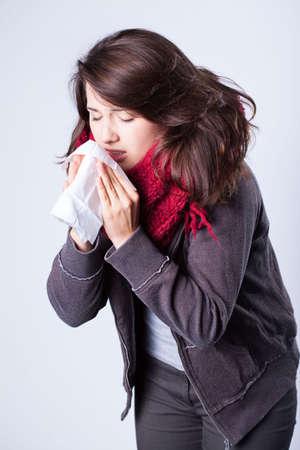 Vertical view of girl having autumn flu