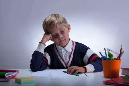 fineliner: Bored student sitting at the desk at home Stock Photo