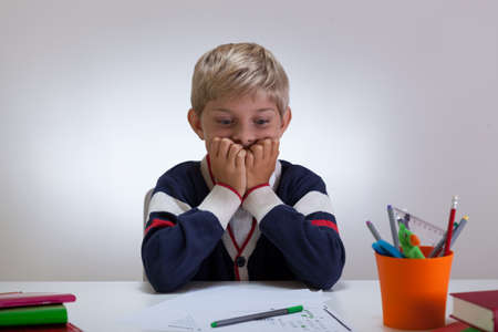 difficult task: View of little student with difficult task Stock Photo
