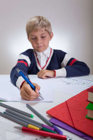 fineliner: Vertical view of child writing in notebook