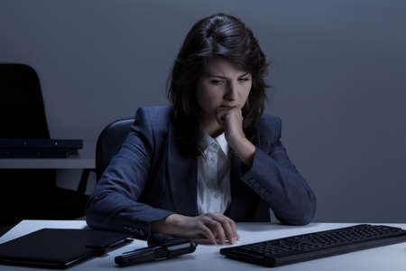 lonely woman: View of woman with problems at work