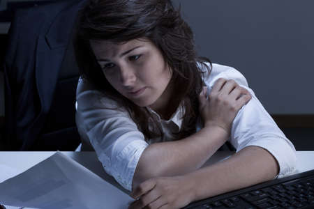resolve: Tired and sleepy businesswoman trying to resolve problem
