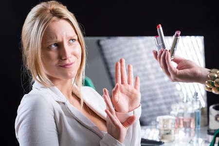 visagiste: Woman refusing color lipstick during wedding makeup